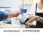 customer using credit cart for... | Shutterstock . vector #1299402838