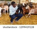 portrait of experienced african ... | Shutterstock . vector #1299419128