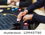 skillful man playing poker ... | Shutterstock . vector #1299437785