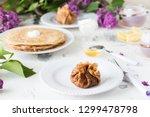 pancakes  thin stuffed pancakes ...   Shutterstock . vector #1299478798