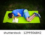 young man read a book on the... | Shutterstock . vector #1299506842