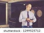 confident cheerful glad male... | Shutterstock . vector #1299525712