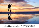 A Photographer In Sunset