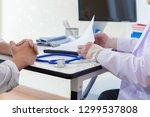 the doctor is diagnosing the... | Shutterstock . vector #1299537808