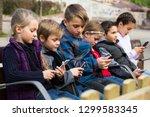 little children posing at... | Shutterstock . vector #1299583345