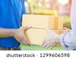 parcel delivery man of a... | Shutterstock . vector #1299606598