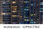 glowing windows in multistory... | Shutterstock . vector #1299617362