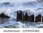 Row Of Frozen Wooden Posts Wit...