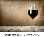 Red Wine Glass On The Wooden...