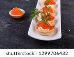 canapes with salmon red caviar... | Shutterstock . vector #1299706432