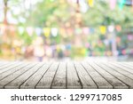 empty wooden table with party... | Shutterstock . vector #1299717085