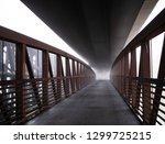 bridge in fog | Shutterstock . vector #1299725215