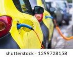 recharging of an electric car... | Shutterstock . vector #1299728158