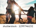 families playing with children... | Shutterstock . vector #1299746152