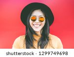 portrait of happy asian girl... | Shutterstock . vector #1299749698