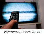 female hand holding tv remote... | Shutterstock . vector #1299793132