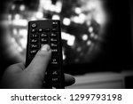 female hand holding tv remote... | Shutterstock . vector #1299793198