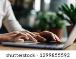 closeup shot hands using laptop ... | Shutterstock . vector #1299855592