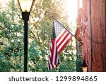 american flag on the red brick... | Shutterstock . vector #1299894865