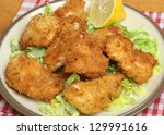 Italian fried chicken fillets in breadcrumbs, herbs and parmesan cheese. - stock photo