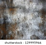 A Rusty Old Metal Plate With...