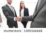 business shaking hands in the... | Shutterstock . vector #1300166668