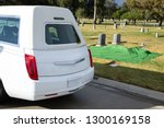 White Hearse Parked Next To A...