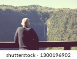man looking for mountain... | Shutterstock . vector #1300196902