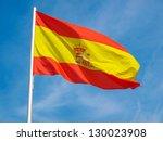 Flag Of Spain Over A Blue Sky