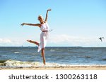 beautiful young woman in a... | Shutterstock . vector #1300263118