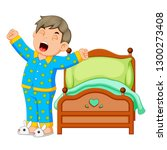 a boy wake up and stretching in ... | Shutterstock .eps vector #1300273408