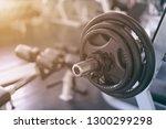 selective focus of barbell row... | Shutterstock . vector #1300299298