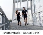 young couple in black sports... | Shutterstock . vector #1300310545