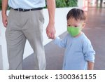 father and son holding hand ... | Shutterstock . vector #1300361155