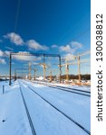 Huge industrial cranes on the construction site near rail road - winter season - stock photo