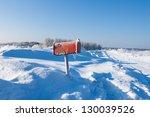 winter frozen mail box under snow - stock photo
