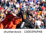 Small photo of Mobile, Alabama / USA - 01/26/2019: Auburn QB (8) Jarrett Stidham is hit from behind by Iowa DE (93) Anthony Nelson during the 2019 Reese's Senior Bowl. Resulting play is a fumble recovered by North.