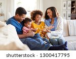 young mixed race family sitting ... | Shutterstock . vector #1300417795