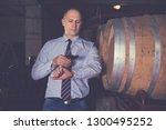 winemaker inspecting quality of ... | Shutterstock . vector #1300495252