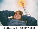 the woman is holding her head... | Shutterstock . vector #1300625338