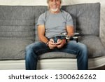 senior man playing with a drone | Shutterstock . vector #1300626262