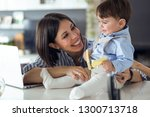 shot of pretty young mother... | Shutterstock . vector #1300713718