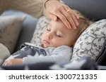 sick child  toddler boy lying... | Shutterstock . vector #1300721335