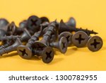 black screws on a yellow... | Shutterstock . vector #1300782955