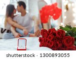 proposal ring and red roses on... | Shutterstock . vector #1300893055