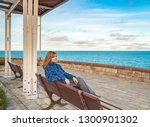 woman sitting bench on the... | Shutterstock . vector #1300901302
