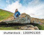 woman sitting stones against... | Shutterstock . vector #1300901305