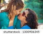 happy mother and daughter in... | Shutterstock . vector #1300906345