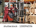 Young Warehouse Workers In...