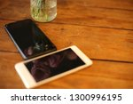 smart phone  on a wooden table... | Shutterstock . vector #1300996195